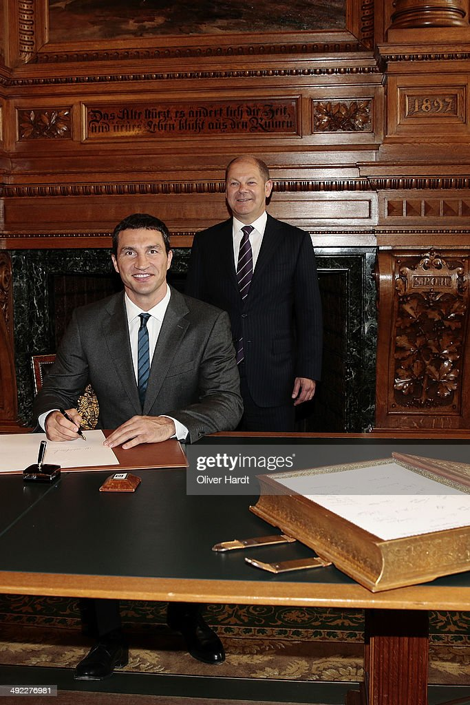 Wladimir Klitschko signs the 'Golden Book of Hamburg's ' at the Hamburg's Rathaus during their visit of the city Hamburg on May 19, 2014 in Hamburg, Germany.