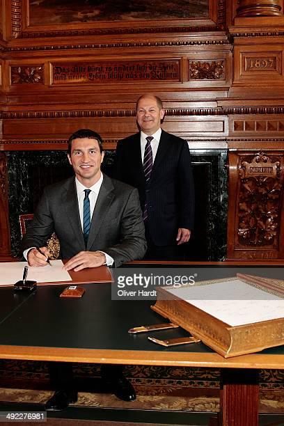Wladimir Klitschko signs the 'Golden Book of Hamburg's ' at the Hamburg's Rathaus during their visit of the city Hamburg on May 19 2014 in Hamburg...