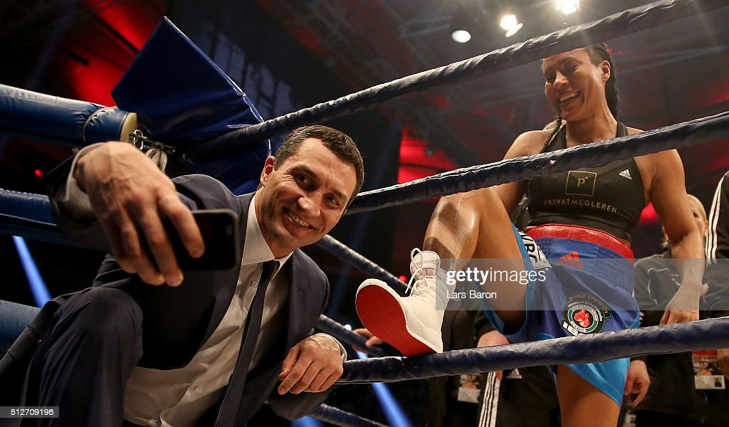 Wladimir Klitschko takes a selfie with winner Cecilia Braekhus after her Welterweight World Championship fight against Chris Namus prior to the IBO Cruiserweight World Championship fight between Marco Huck and Ola Afolabi at Gerry Weber Stadium on February 27, 2016 in Halle, Germany.