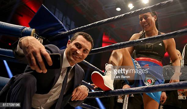 Wladimir Klitschko takes a selfie with winner Cecilia Braekhus after her Welterweight World Championship fight against Chris Namus prior to the IBO...