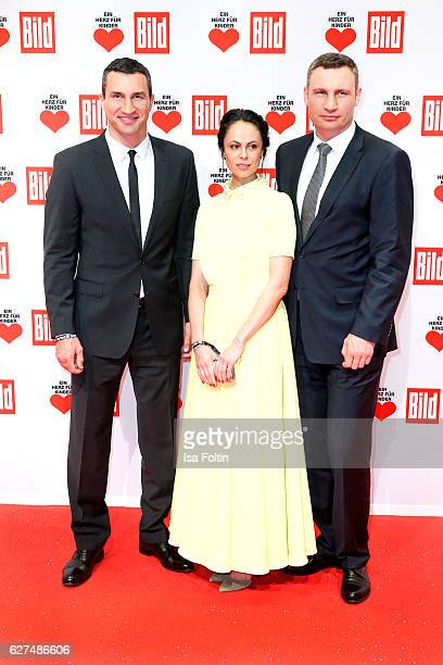 Wladimir Klitschko with his brother Vitali Klitschko and his wife Natalia Klitschko during the Ein Herz Fuer Kinder gala on December 3 2016 in Berlin...