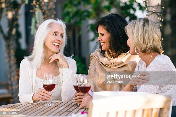 Wmature women drinking red wine