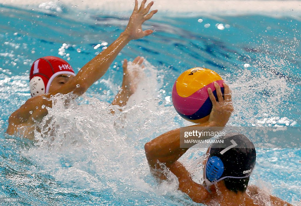 Wo Ka Chan goal keeper of Hong Kong tries to prevent Yusuke Shimizu of Japan from scoring during the two teams water polo game in at the 9th Asian Swimming Championships in Dubai, on November 21, 2012.