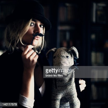WOamn playing with her dog : Stock Photo