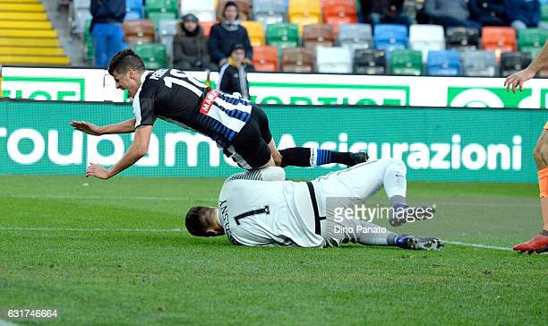 Wojciech Seczecny goalkeeper of AS Roma save a the feet by Stipe Perica of Ucdinese Calcio during the Serie A match between Udinese Calcio and AS...