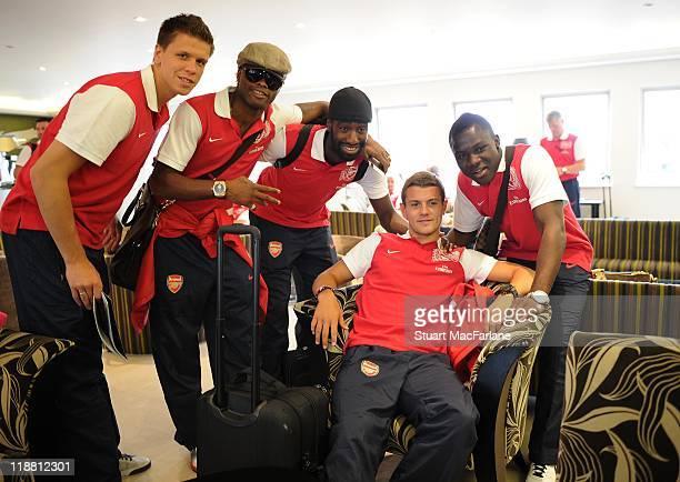 Wojciech Szczesny Alex Song Johan Djourou Jack Wilshere and Emmanuel Frimpong of Arsenal wait to board a flight to Malaysia for the club's preseason...
