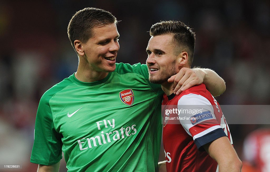 <a gi-track='captionPersonalityLinkClicked' href=/galleries/search?phrase=Wojciech+Szczesny&family=editorial&specificpeople=6539507 ng-click='$event.stopPropagation()'>Wojciech Szczesny</a> and <a gi-track='captionPersonalityLinkClicked' href=/galleries/search?phrase=Carl+Jenkinson&family=editorial&specificpeople=7935131 ng-click='$event.stopPropagation()'>Carl Jenkinson</a> of Arsenal after the UEFA Champions League Play Off Second leg match between Arsenal FC and Fenerbahce SK at Emirates Stadium on August 27, 2013 in London, England.