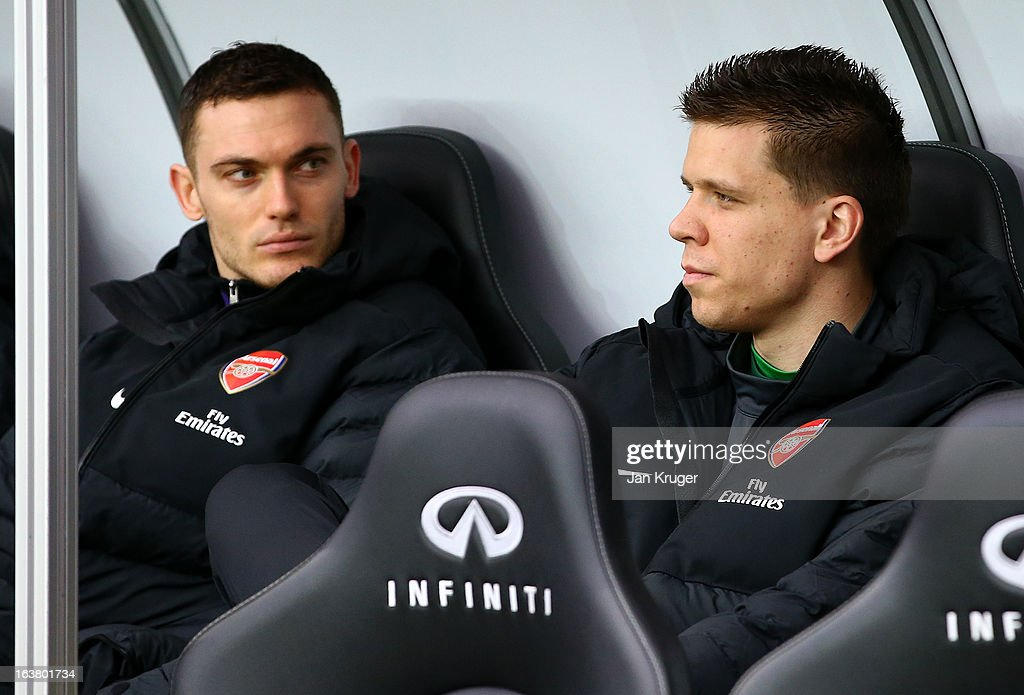Wojciech Szczesny and Thomas Vermaelen of Arsenal look on from the dug out prior to kick off during the Barclays Premier League match between Swansea City and Arsenal at Liberty Stadium on March 16, 2013 in Swansea, Wales.