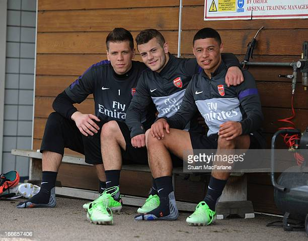 Wojciech Szczesny Jack Wilshere and Alex OxladeChamberlain of Arsenal pose after a training session at London Colney on April 15 2013 in St Albans...