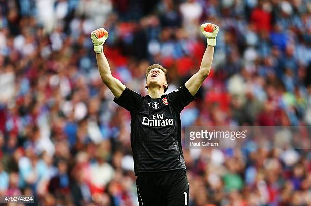 Wojciech Szczesny of Arsenal celebrates during the FA Cup Final between Aston Villa and Arsenal at Wembley Stadium on May 30 2015 in London England