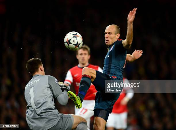 Wojciech Szczesny of Arsenal fouls Arjen Robben of Bayern Muenchen during the UEFA Champions League Round of 16 first leg match between Arsenal and...
