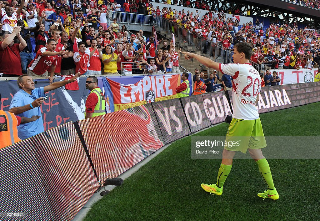Wojciech Szczesny of Arsenal givs his gloves to a fan after the pre season match between New York Red Bulls and Arsenal at Red Bull Arena on July 26, 2014 in Harrison, New Jersey.