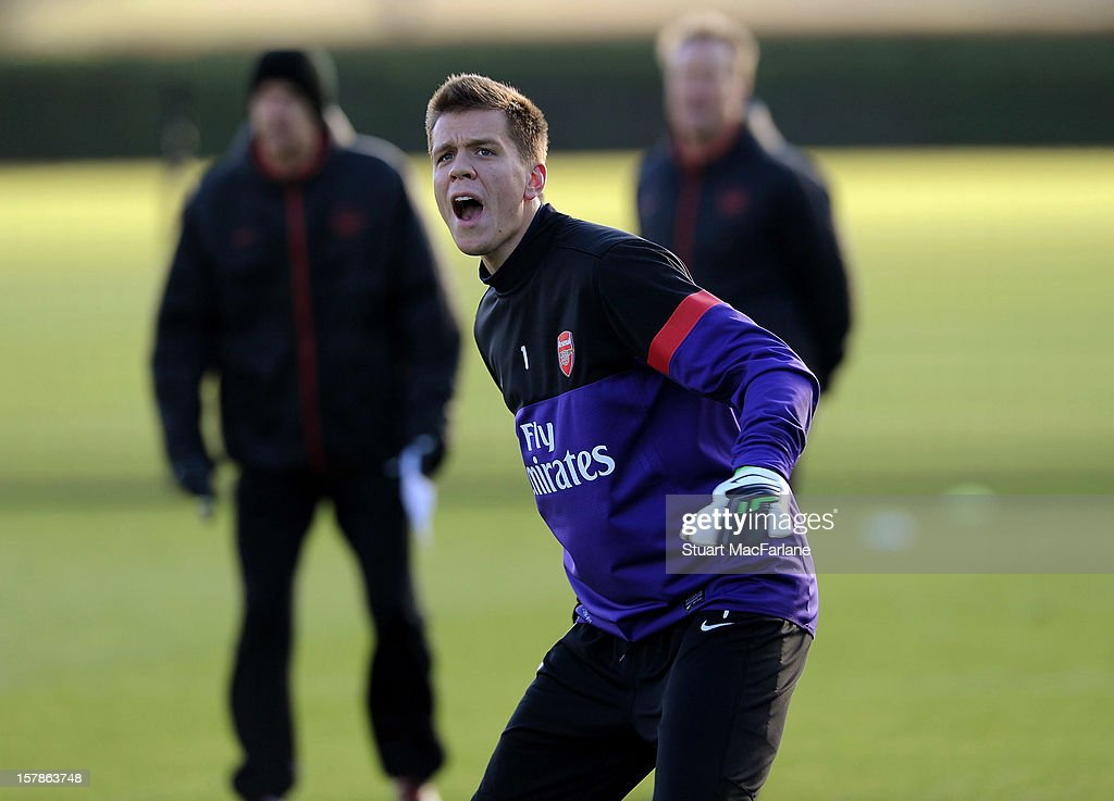 Wojciech Szczesny of Arsenal reacts during a training session at London Colney on December 07, 2012 in St Albans, England.