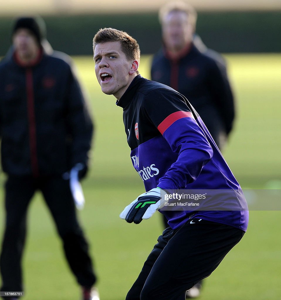 <a gi-track='captionPersonalityLinkClicked' href=/galleries/search?phrase=Wojciech+Szczesny&family=editorial&specificpeople=6539507 ng-click='$event.stopPropagation()'>Wojciech Szczesny</a> of Arsenal reacts during a training session at London Colney on December 07, 2012 in St Albans, England.