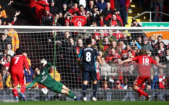 Wojciech Szczesny of Arsenal saves the penalty kick by Dirk Kuyt of Liverpool during the Barclays Premier League match between Liverpool and Arsenal...