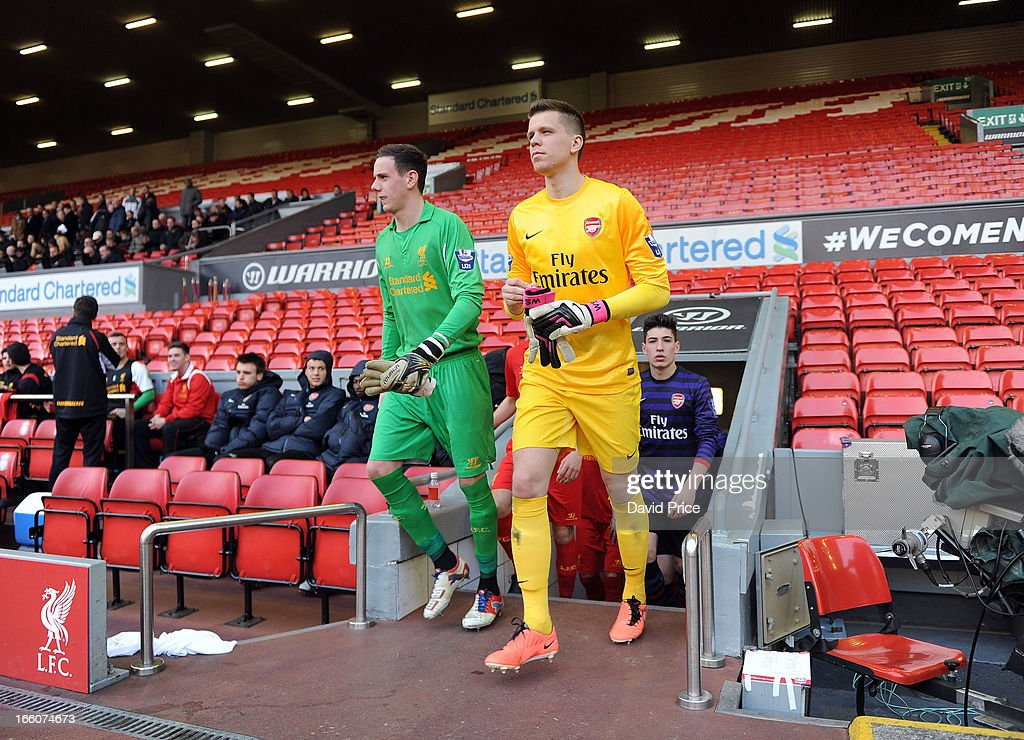 <a gi-track='captionPersonalityLinkClicked' href=/galleries/search?phrase=Wojciech+Szczesny&family=editorial&specificpeople=6539507 ng-click='$event.stopPropagation()'>Wojciech Szczesny</a> of Arsenal walks out with Danny Ward of Liverpool before the Barclays Under-21 League match between Liverpool U21 and Arsenal U21 at Anfield on April 08, 2013 in Liverpool, England.