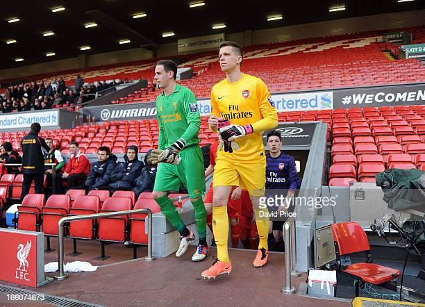 Wojciech Szczesny of Arsenal walks out with Danny Ward of Liverpool before the Barclays Under21 League match between Liverpool U21 and Arsenal U21 at...