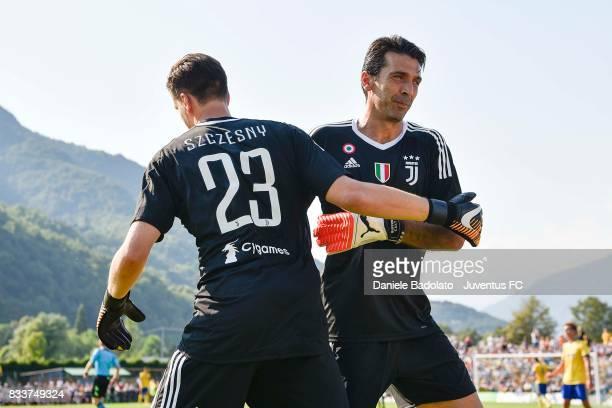 Wojciech Szczesny of Juventus goes in for team mate Gianluigi Buffon during the preseason friendly match between Juventus A and Juventus B on August...