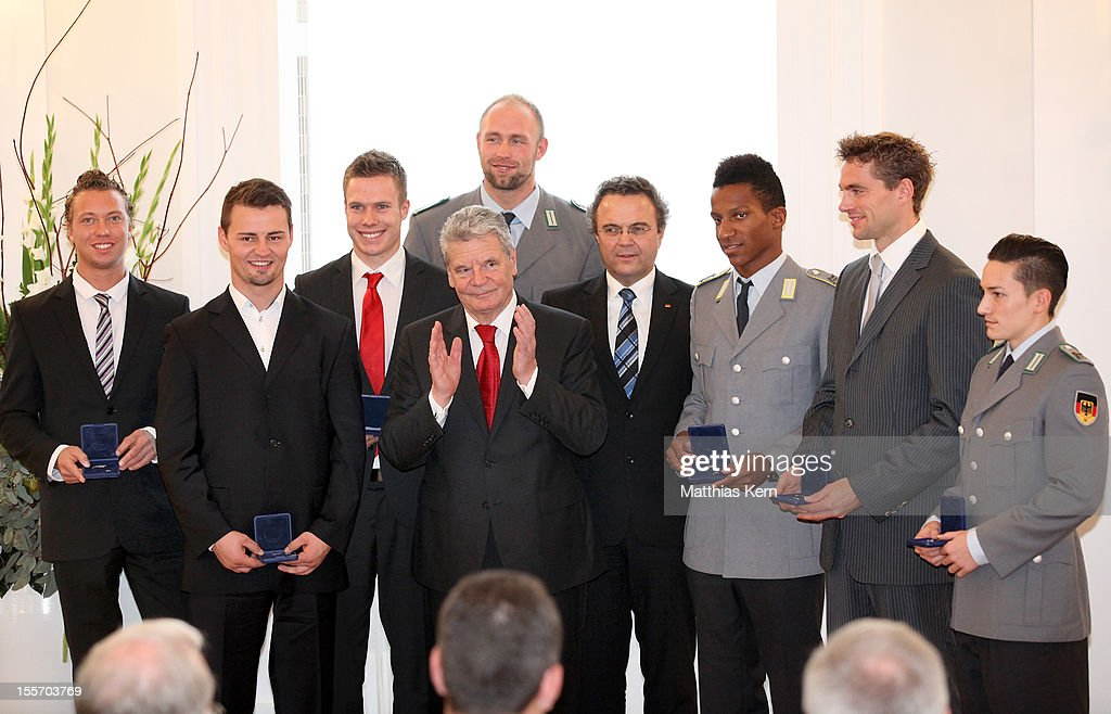 Wojtek Czyz, Heinrich Popow, Markus Rehm, German President Joachim Gauck, Robert Harting, German Interior Minister Hans Peter Friedrich, Raphael Holzdeppe, Bjoern Otto and Marcel Nguyen (L-R) pose during the 'Silbernes Lorbeerblatt' award ceremony at Schloss Bellevue on November 7, 2012 in Berlin, Germany.
