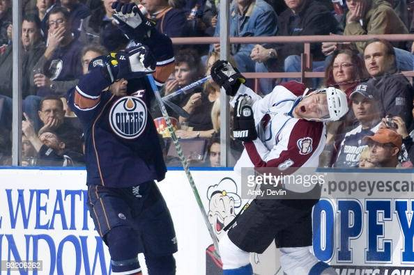 Wojtek Wolski of the Colorado Avalanche reacts to a high hit from Sheldon Souray of the Edmonton Oilers at Rexall Place on November 18 2009 in...