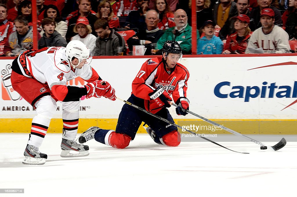 <a gi-track='captionPersonalityLinkClicked' href=/galleries/search?phrase=Wojtek+Wolski&family=editorial&specificpeople=240466 ng-click='$event.stopPropagation()'>Wojtek Wolski</a> #17 of the Washington Capitals drops to his knees as Jamie McBain #4 of the Carolina Hurricanes defends during an NHL game at Verizon Center on March 12, 2013 in Washington, DC.