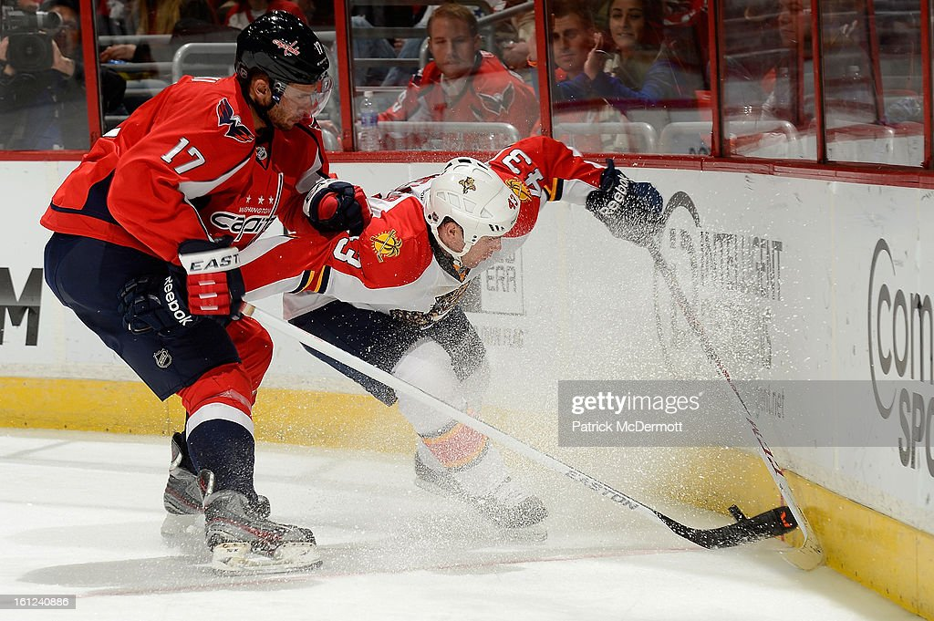 <a gi-track='captionPersonalityLinkClicked' href=/galleries/search?phrase=Wojtek+Wolski&family=editorial&specificpeople=240466 ng-click='$event.stopPropagation()'>Wojtek Wolski</a> #17 of the Washington Capitals gets physical with Mike Weaver #43 of the Florida Panthers in the third period of an NHL hockey game at Verizon Center on February 9, 2013 in Washington, DC.