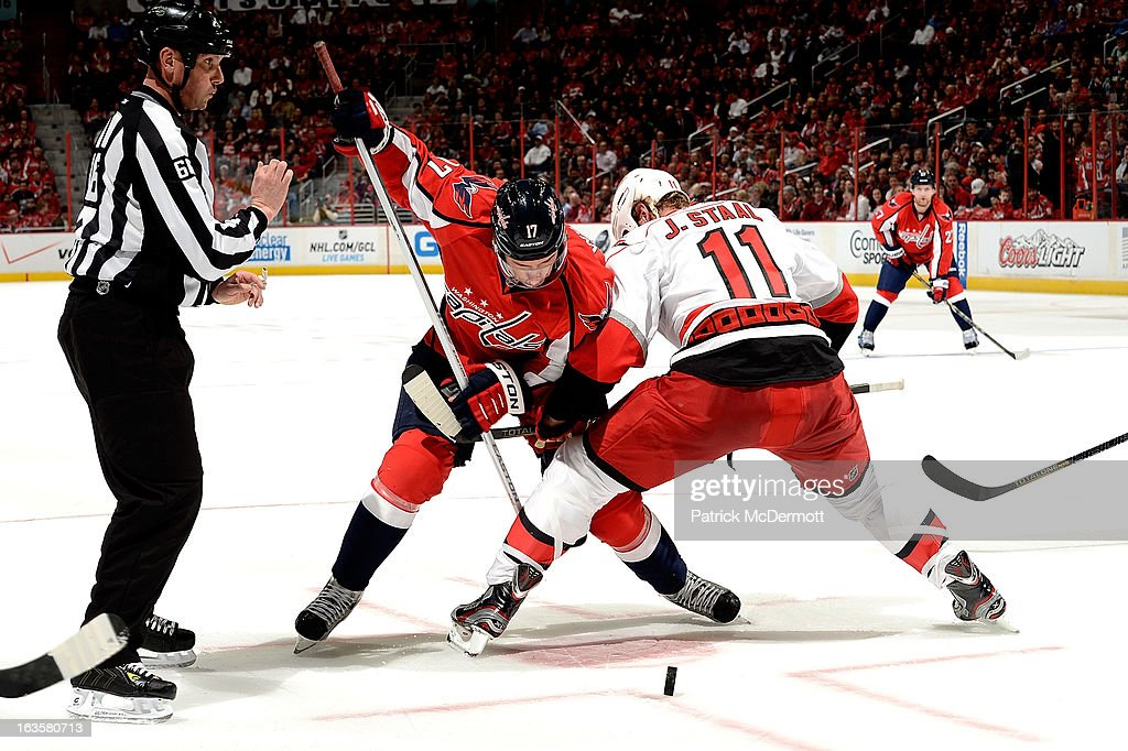 <a gi-track='captionPersonalityLinkClicked' href=/galleries/search?phrase=Wojtek+Wolski&family=editorial&specificpeople=240466 ng-click='$event.stopPropagation()'>Wojtek Wolski</a> #17 of the Washington Capitals takes a faceoff against <a gi-track='captionPersonalityLinkClicked' href=/galleries/search?phrase=Jordan+Staal&family=editorial&specificpeople=533044 ng-click='$event.stopPropagation()'>Jordan Staal</a> #11 of the Carolina Hurricanes during an NHL game at Verizon Center on March 12, 2013 in Washington, DC.