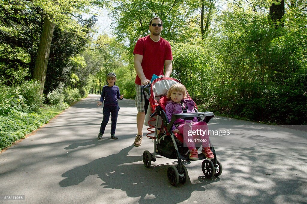 Wolf from Germany walks with his children Tom and Marie during Father's Day in the Hasenheide park in Berlin, Germany on May 5, 2016.