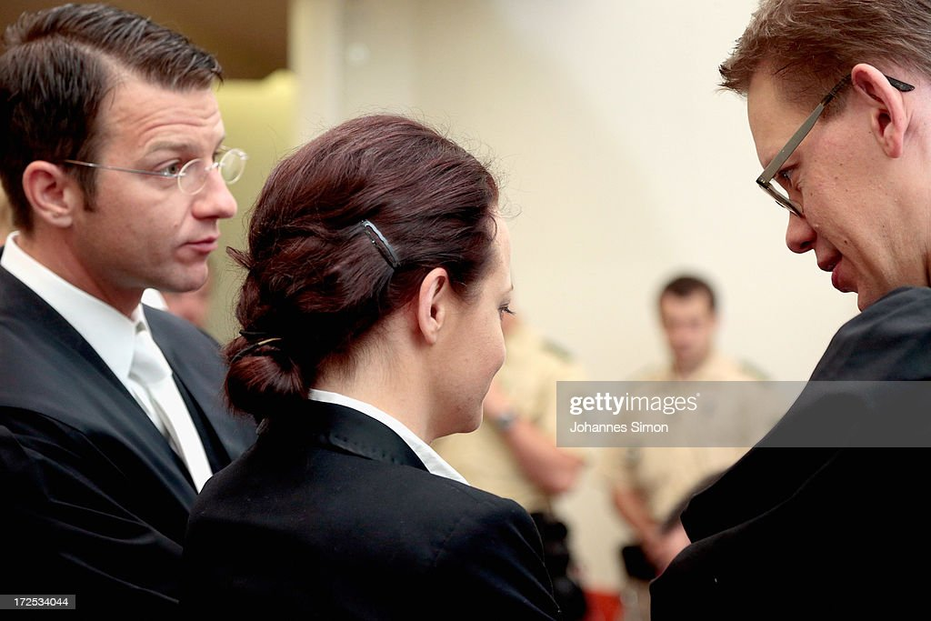 <a gi-track='captionPersonalityLinkClicked' href=/galleries/search?phrase=Wolfgang+Heer+-+Lawyer&family=editorial&specificpeople=14887066 ng-click='$event.stopPropagation()'>Wolfgang Heer</a> (L) and <a gi-track='captionPersonalityLinkClicked' href=/galleries/search?phrase=Wolfgang+Stahl&family=editorial&specificpeople=654884 ng-click='$event.stopPropagation()'>Wolfgang Stahl</a> (R), lawyers of defendant <a gi-track='captionPersonalityLinkClicked' href=/galleries/search?phrase=Beate+Zschaepe&family=editorial&specificpeople=8630982 ng-click='$event.stopPropagation()'>Beate Zschaepe</a> (C), chat prior to the trial during day 18 of the NSU neo-Nazis murder trial at the Oberlandgericht Muenchen court on July 3, 2013 in Munich, Germany. <a gi-track='captionPersonalityLinkClicked' href=/galleries/search?phrase=Beate+Zschaepe&family=editorial&specificpeople=8630982 ng-click='$event.stopPropagation()'>Beate Zschaepe</a> is the main defendant and is on trial for her role in assisting Uwe Boehnhardt and Uwe Mundlos in the murder of nine immigrants and one policewoman across Germany between 2000 and 2007. Together the trio called themselves the NSU, or National Socialist Underground, and were able to operate unbeknownst to police until Mundlos and Boehnhardt were cornered in 2011 after the two robbed a bank. Four other co-defendants, including Ralf Wohlleben, Holder G., Carsten S. and Andre E., are accused of assisting the trio. Carsten S. and Holger G. have declared themselves willing to give limited testimonies, while Zschaepe has thus far remained silent and refuses to answer any questions by the court.