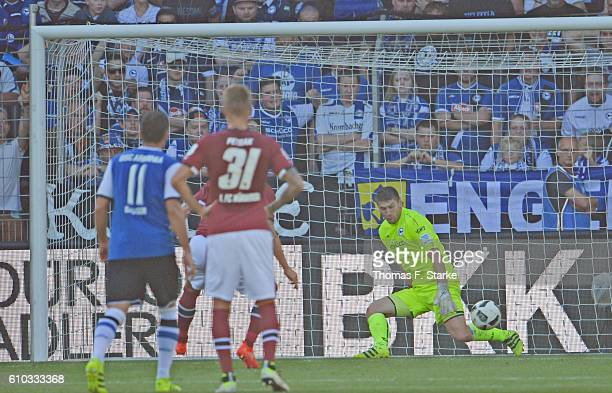 Wolfgang Hesl of Bielefeld saves a penalty by Guido Burgstaller of Nuernberg during the Second Bundesliga match between DSC Arminia Bielefeld and 1...