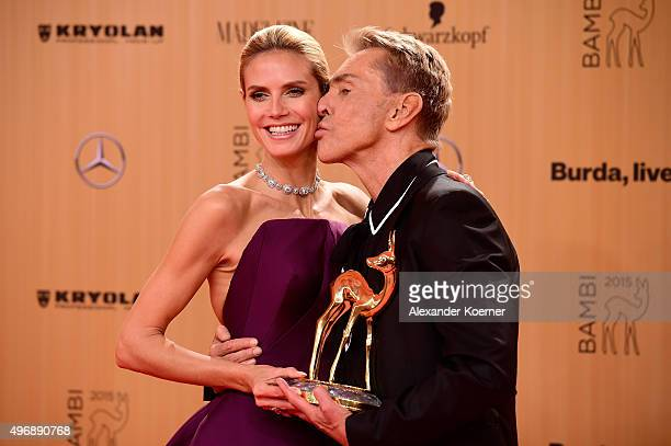 Wolfgang Joop kisses Heidi Klum at the Bambi Awards 2015 winners board at Stage Theater on November 12 2015 in Berlin Germany