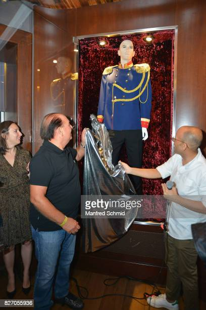 Wolfgang Kosmata and Joao Santos Da Cunha unveil the Falco memorabilia during the 3rd birthday party of the Hard Rock Cafe Vienna on August 6 2017 in...