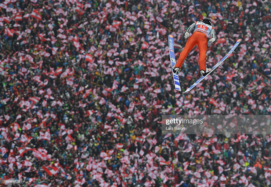 Wolfgang Loitzl of Austria competes during the first round for the FIS Ski Jumping World Cup event of the 61st Four Hills ski jumping tournament at Bergisel-Stadion on January 4, 2013 in Innsbruck, Austria.