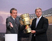 Wolfgang Niersbach general seceratary of the DFB hands over the cup to Klaus Wowereit mayor of Berlin during the DFB cup handover at Baerensaal on...