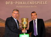 Wolfgang Niersbach general seceratary of the DFB hands over the cup to Klaus Wowereit mayor of Berlin during the DFB cup handover at the city hall on...