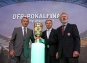 Wolfgang Niersbach general secretary of the DFB Klaus Wowereit mayor of Berlin and Paul Breitner representative of FC Bayern Muenchen pose with the...