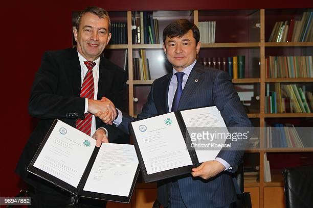 Wolfgang Niersbach general secretary of the German Football Association signs a cooperation treaty with Sayan Khamitzhanov general secretary of the...