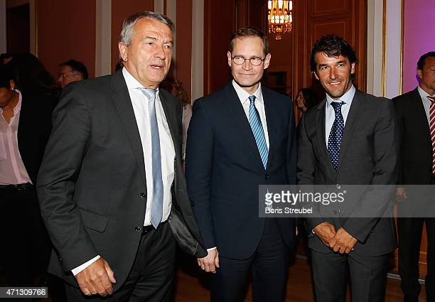 Wolfgang Niersbach president of German Football Association and UEFA Committee member poses with Michael Mueller mayor of Berlin and KarlHeinz Riedle...
