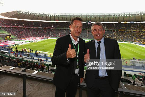 Wolfgang Niersbach President of German Football Association jokes with Tom Hanks prior to the DFB Cup Final match between Borussia Dortmund and FC...