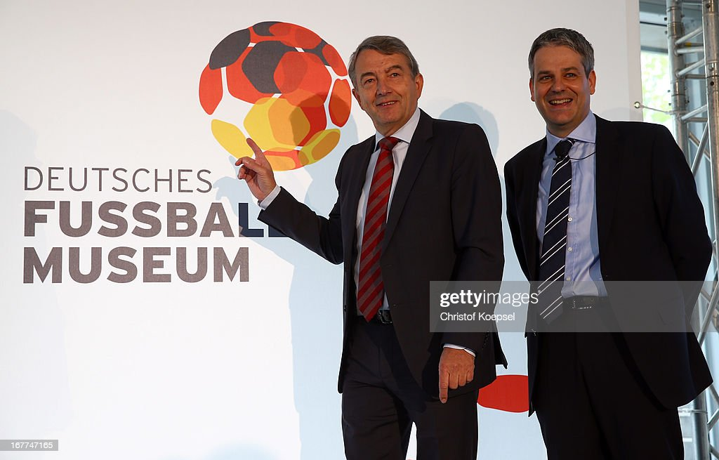 Wolfgang Niersbach, president of the German Football Association and Manuel Neukircher, director foundation DFB football museum pose in front of the official logo of the Football Museum during the DFB Football Museum groundbreaking ceremony at Harenberg City Center on April 29, 2013 in Dortmund, Germany.
