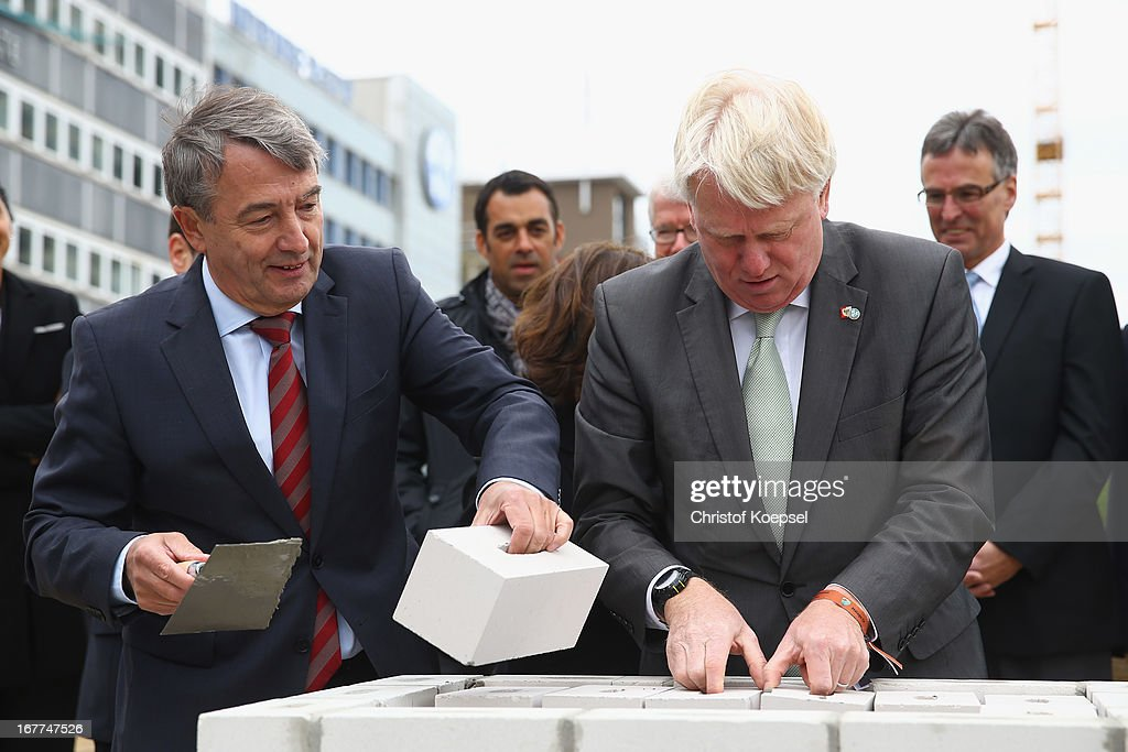Wolfgang Niersbach, president of the German Football Association and Ullrich Sierau, mayor of Dortmund lay down stones at construction area during the DFB Football Museum groundbreaking ceremony at Koenigswall on April 29, 2013 in Dortmund, Germany.