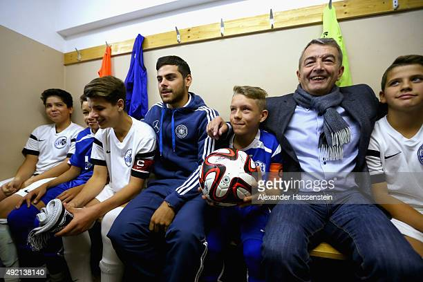 Wolfgang Niersbach President of the German Football Association and Kevin Volland of the German national team talk to the players in the dressing...