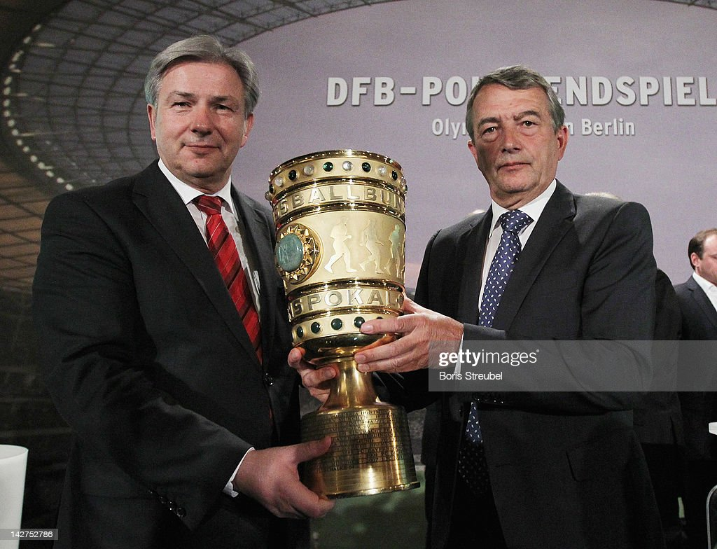 Wolfgang Niersbach (R), president of the German Football Association (DFB) hands over the cup to Klaus Wowereit, mayor of Berlin (L) during the DFB cup handover at Wappensaal of the Rote Rathaus on April 12, 2012 in Berlin, Germany.
