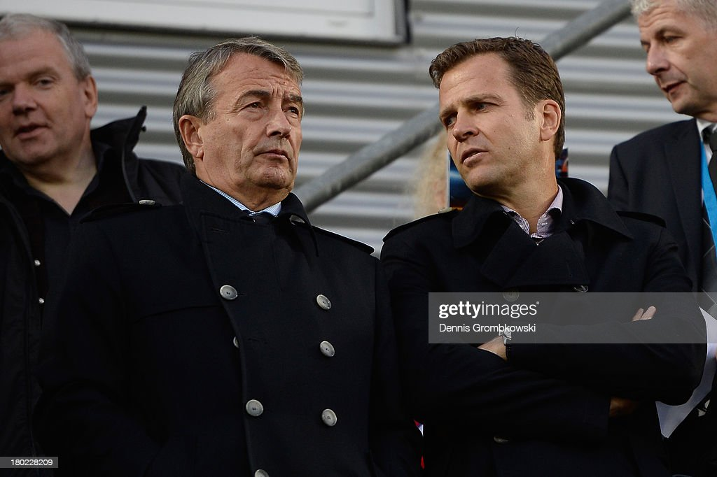 Wolfgang Niersbach, president of the German Football Federation DFB and Germany manager Oliver Bierhoff talk prior to the FIFA 2014 World Cup Qualifier match between Faeroe Islands and Germany on September 10, 2013 in Torshavn, Denmark.