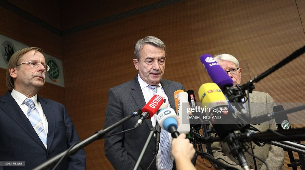 Wolfgang Niersbach President of the German Football Federation gives a statement to announce his resignation next to Reinhard Rauball Vice President...