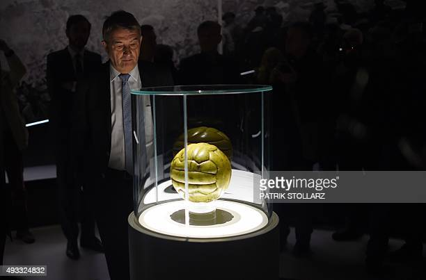 Wolfgang Niersbach President of the German Football Federation watches the football of the 1954 final World Cup match during the Media Day of of the...