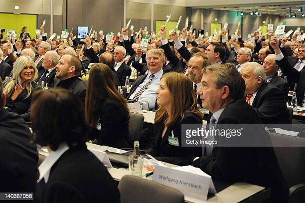 Wolfgang Niersbach sits in the audience as the delegates elect him new DFB president during the DFB federal meeting at Steigenberger Airport Hotel on...