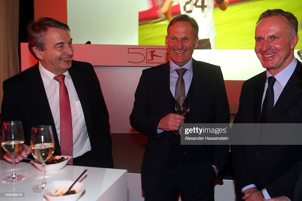 Wolfgang Niersbach (L) smiles with Hans-Joachim Watzke and Karl-Heinz Rummenigge (R) during the DFL new year's reception at the Thurn und Taxis Palais on January 15, 2013 in Frankfurt am Main, Germany.