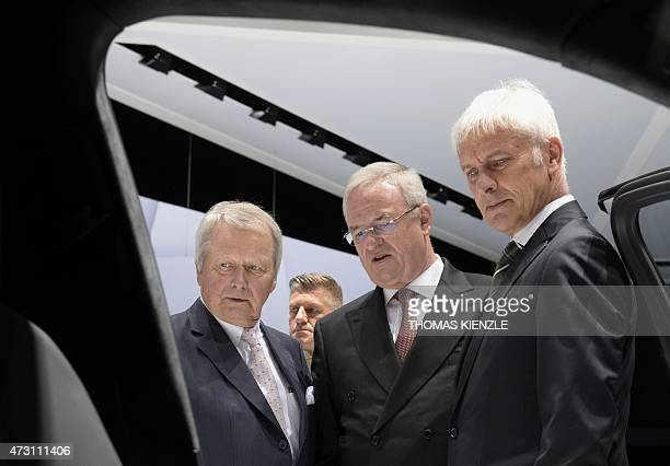 Wolfgang Porsche chairman of the board of directors of Porsche Automobil Holding SE Martin Winterkorn CEO of the company and Matthias Mueller CEO of...