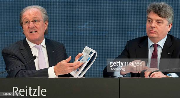 Wolfgang Reitzle chief executive officer of Linde AG left gestures as Georg Denoke chief financial officer of Linde AG listens during the company's...